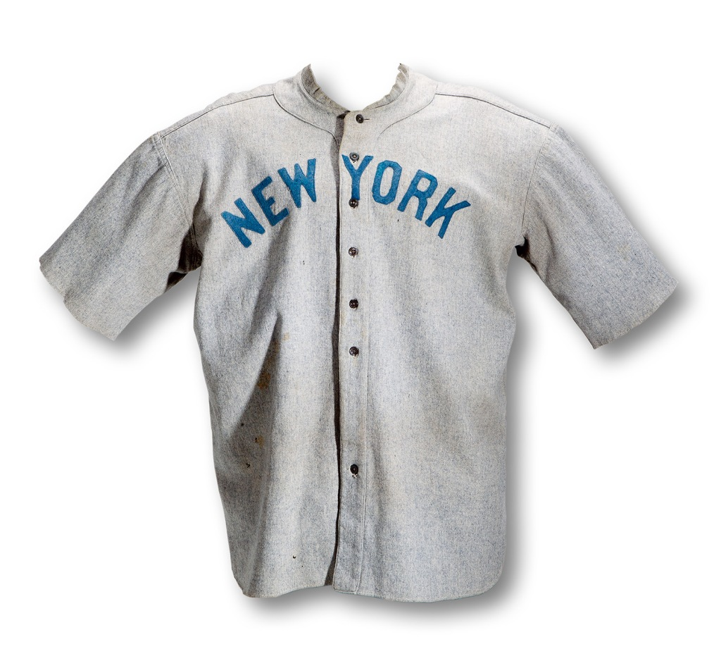 A circa 1920 gray flannel road jersey with the words New York across the front in blue, worn by Babe Ruth. It sold for $4.4 million in 2012.