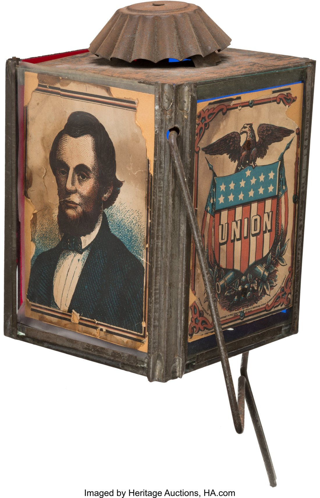 """This rare circa 1860s parade lantern features an image of Abraham Lincoln on one panel and a spread-winged eagle sitting on a shield with the word """"union"""" on it."""