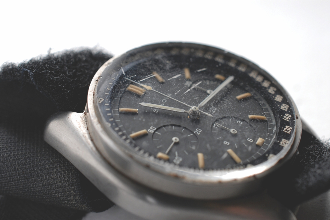 Closeup of the dial of the Bulova chronograph that astronaut David Scott wore on the surface of the moon during the Apollo 15 mission. Moon dust is visible on the face of the wristwatch.