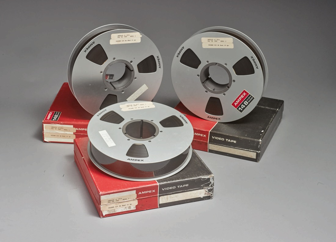 The three AMPEX tapes of the Apollo 11 moon walk, each shown on top of their red and black boxes.