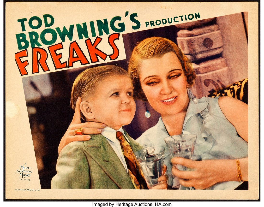 A lobby card from the 1932 MGM film Freaks that depicts actress Olga Baclanova and little person Harry Earles.
